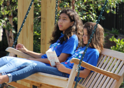 A book and a swinging bench