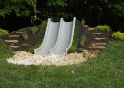 sliding hill with boulder steps