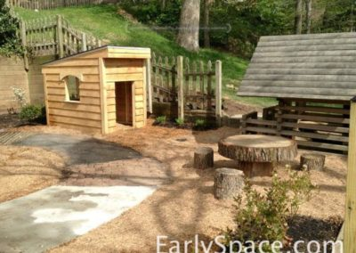 Two playhouses and a log table